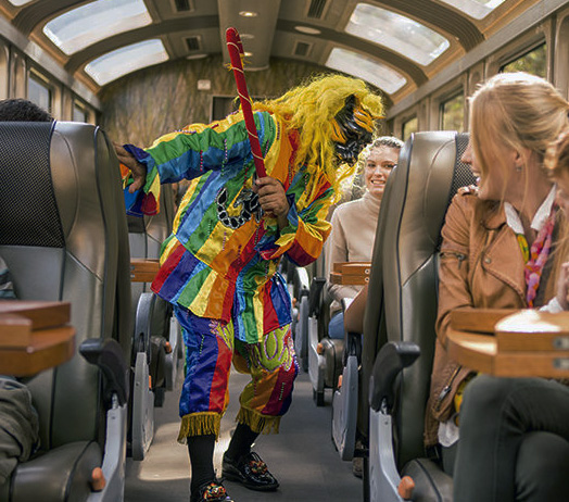 Enjoy a colorful show on board in the Vistadome Train to Machu Picchu